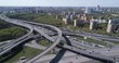 Aerial top view of road junction and transport traffic with vehicle movement by drone. Drone video of Moscow junction road at day time. Dmitrovskoe shosse, Russia.