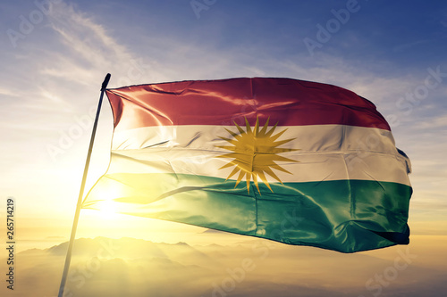 Fotografie, Obraz  Kurdistan flag waving on the top sunrise mist fog