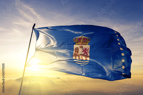 Ourense province of Spain flag waving on the top sunrise mist fog