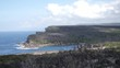 Pan shot of a wide view over the coastine in the royal national park in Australia near Sydney during a beautiful day.