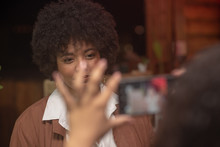 Woman With Afro Being Photogra...