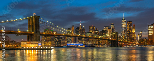Foto auf Gartenposter Brooklyn Bridge Banner and cover scene of New york Cityscape with Brooklyn Bridge over the east river at the twilight time, USA downtown skyline, Architecture and transportation concept
