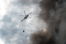 Rescue Helicopter Drops Water Extinguishes The Fire