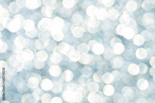 Photo  Blue glittering lights. Blurred abstract background.