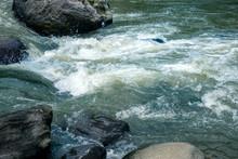 Wild River Water Stream Between Big Granite Rock. Rivulet Water Flowing Rushing By Big Stone Boulder.