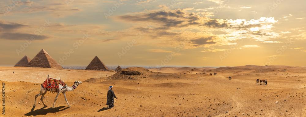 Fototapeta The Pyramids of Giza, desert panorama with the bedouins, Egypt