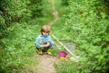 Little Helper In Garden. Planting Flowers. Growing Plants. Take Care Of Plants. Boy With Watering Can. Small Boy Child Love Nature. Digging Soil For Green Plants. Kindergarten Kid. Spring Garden