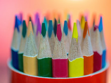 Set Of Colored Pencils In A Ro...