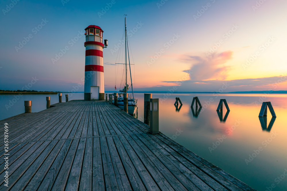 Fototapety, obrazy: Lighthouse at Lake Neusiedl, Podersdorf am See, Burgenland, Austria. Lighthouse at sunset in Austria. Wooden pier with lighthouse in Podersdorf on lake Neusiedl in Austria.