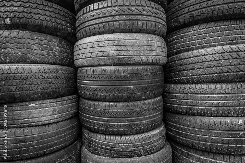 Fototapety, obrazy: Old and used car tires. Background. Black and white.