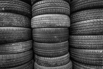Old and used car tires. Background. Black and white.