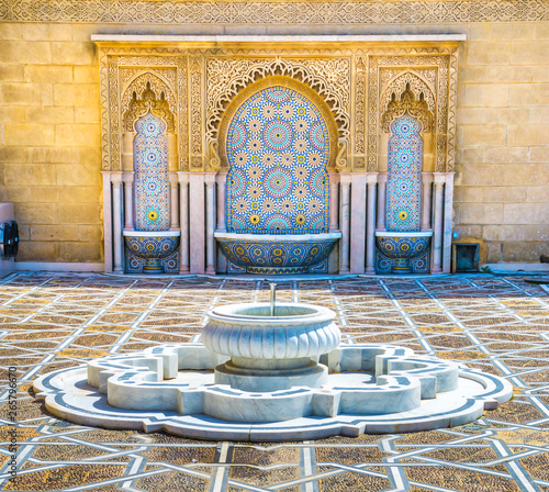 Foto auf Leinwand Altes Gebaude Amazing moroccan style fountain with fine colorful mosaic tiles at the Mohammed V mausoleum in Rabat Morocco. Artistic picture. Beauty world.