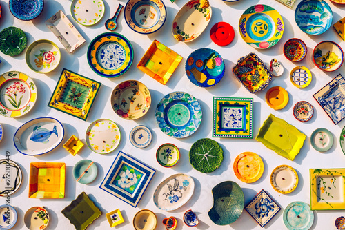 Foto  Collection of colorful Portuguese ceramic pottery, local craft products from Portugal