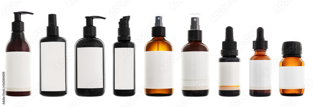 Fototapeta Collection of cosmetic bottles isolated on white background