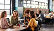 canvas print picture Four Young Female Friends Meeting Sit At Table In Coffee Shop And Talk