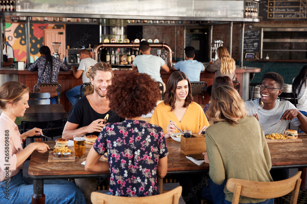 Fototapety, obrazy: Group Of Young Friends Meeting For Drinks And Food In Restaurant