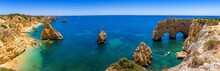 Natural Caves At Marinha Beach, Algarve Portugal. Rock Cliff Arches On Marinha Beach And Turquoise Sea Water On Coast Of Portugal In Algarve Region.