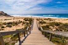 View Of The Monte Clerigo Beach On The Western Coastline Of Portugal, Algarve. Stairs To Beach Praia Monte Clerigo Near Aljezur, Costa Vicentina, Portugal, Europe.