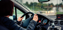 Woman Driving Car On The Motorway In The Rain