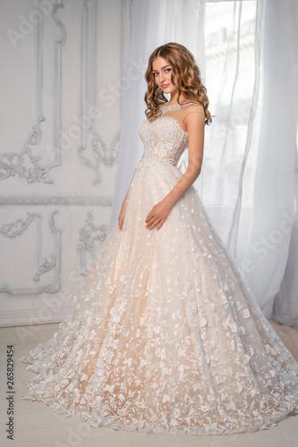 Fotografía sweet bride in dress by the window, happy woman
