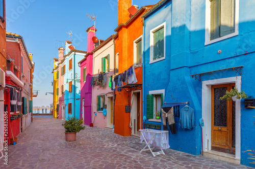 Canvas Prints Narrow alley Street with colorful buildings in Burano island, Venice, Italy. Architecture and landmarks of Burano, Venice postcard. Scenic canal and colorful architecture in Burano island near Venice, Italy