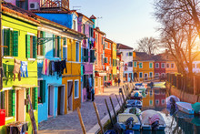 Laundry Hanging Out Of Typical Houses Of Burano Island, Venice, Italy. Multicolored Buildings And Laundry Drying On The Street In Burano, Venice, Italy
