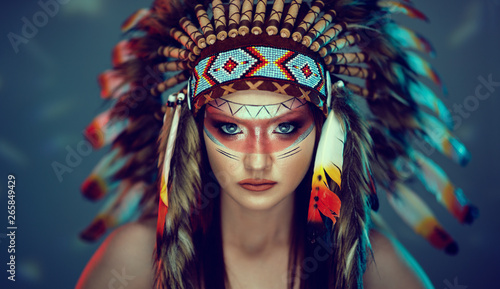 Photo young girl in costume native American Indian