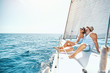 canvas print picture - Young man and woman Relaxing on a Yacht..