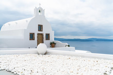Traditional Whitewashed Greek Orthodox Church In Oia, Santorini, Greece