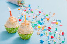 Birthday Hat With Confetti And Cupcake On Blue Paper Background