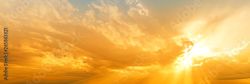 sunset sky panorama landscape background natural color of evening landscape with setting sun light coming through clouds panoramic view - 265863821
