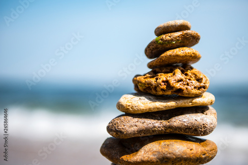 Photo cairn on sea background. pyramid