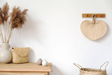 Stylish Korean Interior Of Living Room With  Elegant Accessories, Flowers In Vase, Wooden Shelf, Basket And Hanging Rattan Leaf. Minimalistic Concept Of Home Decor. Template. Copy Space. Bright.