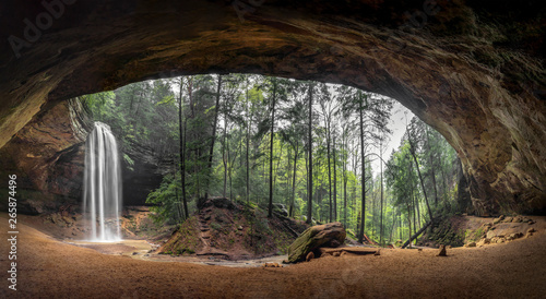 Inside Ash Cave Panorama - Located in the Hocking Hills of Ohio, Ash Cave is an enormous sandstone recess cave adorned with a beautiful waterfall after spring rains.