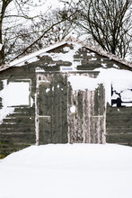 Exterior View Of A Grey Wooden Garden Shed With Snow-covered Windows.,Aston Rowant