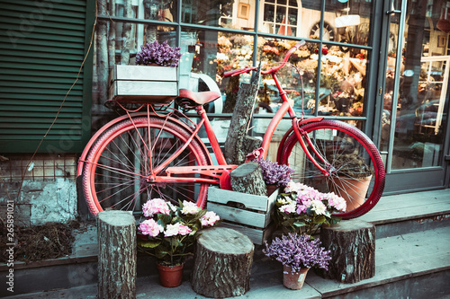 Türaufkleber Fahrrad Summer landscape with a bike in the style of Provence. Urban bike parked to a flower shop. Bicycle with a basket for flowers stands near a beautiful place.