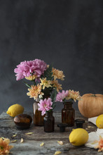Pink And Orange Flowers On Vintage Vases