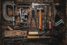 Old Construction Tools On A Wooden Workbench Flat Lay Background. Carpenter Table. Woodwork.