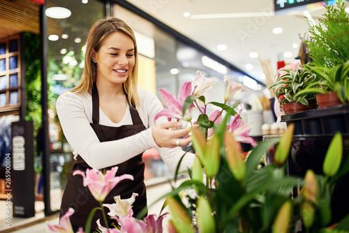 Florist arranging flowers in flower shop
