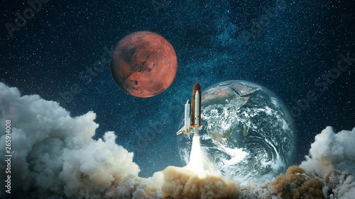 Photo Stands Universe Spacecraft takes off into the starry sky with the planet Earth and the planet Mars. Rocket flies to the planet. Concept of interplanetary travel. Space