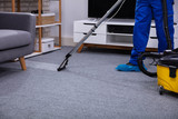 Fototapeta Panels - Male Janitor Cleaning Carpet