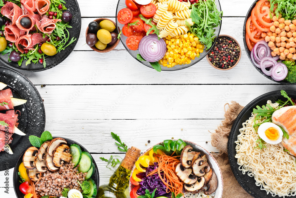 Fototapety, obrazy: Buddha bowl on a white wooden background. Assortment of healthy food. Top view. Free space for your text.