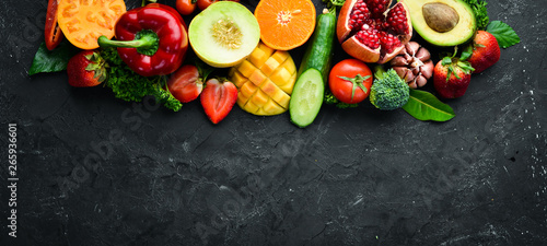 Poster Cuisine Fresh fruits, vegetables and berries. On a black background. Banner Top view. Free space for your text.