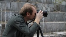 Male Photographer Taking Pictures In An Abandoned Marble Quarry