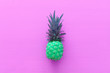 canvas print picture - abstract photo of green pineapple over pink wooden background. Beach and tropical theme. Top view