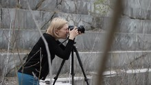Woman Photographer Photographs In An Abandoned Marble Quarry