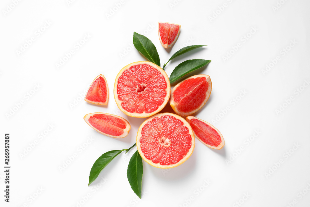 Fotografie, Obraz Grapefruits and leaves on white background, top view