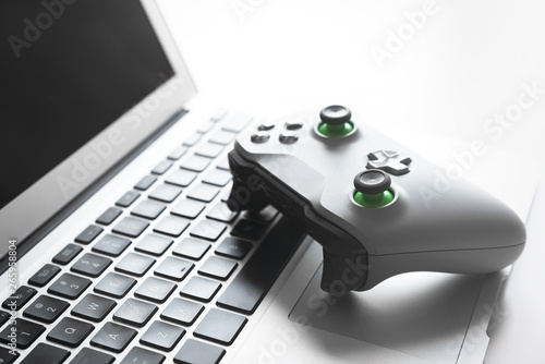 Fototapety, obrazy: Wireless game pad controller on laptop keyboard