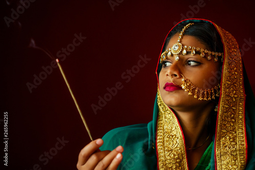 portrait indian beautiful female in golden rich jewelery and tradition saree face closeup professional make-up wearing bindi on head Canvas Print