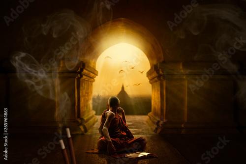 Valokuvatapetti Novice buddhist monk inside a temple in the Bagan Valley